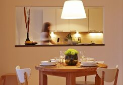 A dining area with a serving hatch into the kitchen