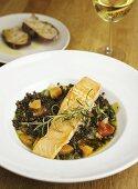 Lentil soup with salmon fillet