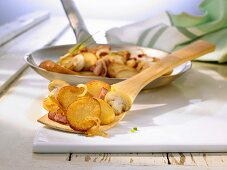 Roast potatoes with onions, bacon and mushrooms