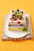 Easter terrine with blueberries, gooseberries, peaches and strawberries
