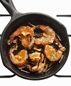 Shrimps with garlic and chilli in a cast iron pan