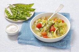 Minestrone with orzo pasta and cherry tomatoes