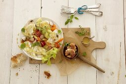 Vegetable salad with goat's cheese wrapped in bacon