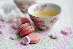 Green teas with macaroons and sugar flower rakugan (Japanese sweets)