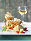 Baked cheese parcels with fruit salad