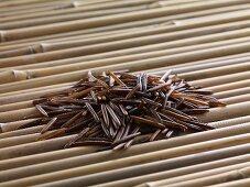 Wild rice on bamboo sticks