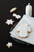 Shortbread biscuits with white icing (an angel and a star)