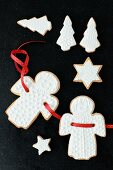 Shortbread biscuits with white icing (angels, stars and Christmas trees)