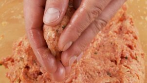 Burgers being shaped from minced meat dough