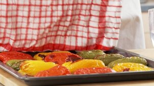 Hot peppers being covered with a damp cloth