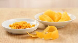 Orange zest being grated, orange being filleted (German Voice Over)