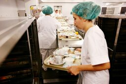 Trays of food being prepared in a commercial kitchen