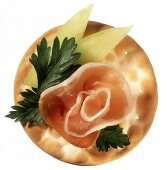 Cracker with Prosciutto and Honeydew Melon