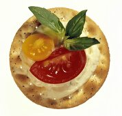 Cracker with Cheese Spread and Tomato