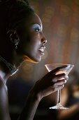 Profile of Woman in Nightclub Holding Martini