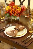 Place Setting with Cloth Napkin on Plate on Holiday Table Setting