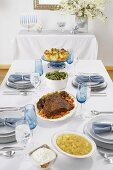 Full Hanukkah Meal on Set Table