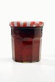 A Single Jar of Strawberry Jam on a White Background