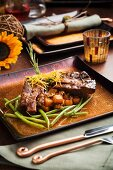 Beef Short Ribs Over Cubed Potatoes and Green Beans