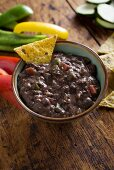 Bowl of Black Bean Dip with Tortilla Chip