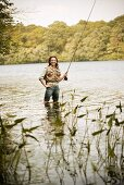 Woman with Fly Rod in River