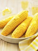 Butter Melting on Four Ears of Corn