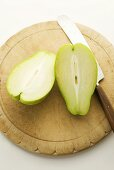 Halved Chayote on Cutting Board