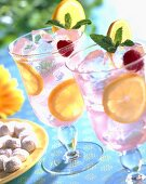 Pink Lemonade in Glasses with Mint and Raspberry Garnish