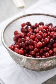 Cranberries in a Colander on Dish Cloth