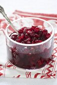 Cranberry sauce in glass dish on tea towel