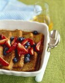 Cinnamon Bread Pudding Topped with Mixed Berries