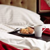 Breakfast in bed with croissants and coffee