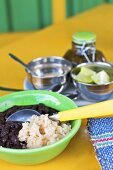 Bowl of Black Beans and Rice with Spoon; Limes