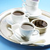 Two Cups of Dark Chocolate Espresso; Dish of Chocolate Squares