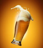 Beer foam coming out of a glass