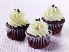 Three red velvet cupcakes