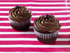 Two Mocha Cupcakes with Chocolate Covered Coffee Beans