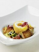 Breaded egg on duck breast with prosciutto
