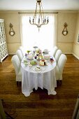 Dining Table Set with Many Assorted Cakes; In Dining Room