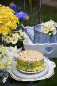 A decorated cake and spring flowers