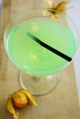 A cocktail made with pistachio syrup, bourbon and lime juice
