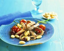 Octopus with broad beans and cherry tomatoes