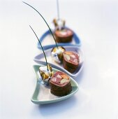 Meat and vegetable roulades in cep sauce