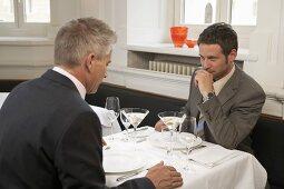 Two men sitting in a restaurant