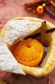 Mandarin orange with cinnamon in puff pastry