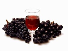 Purple Grapes with a Glass of Red Wine