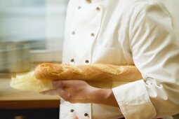 Chef with baguette under his arm
