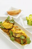 Steamed monk fish with curry sauce, jasmin rice and coriander (Asia)