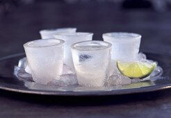 Frozen Vodka Shots on a Tray with Lime