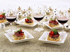 Canapes with roast beef and red wine